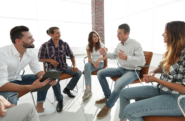 Group of people sitting in a circle having a discussion